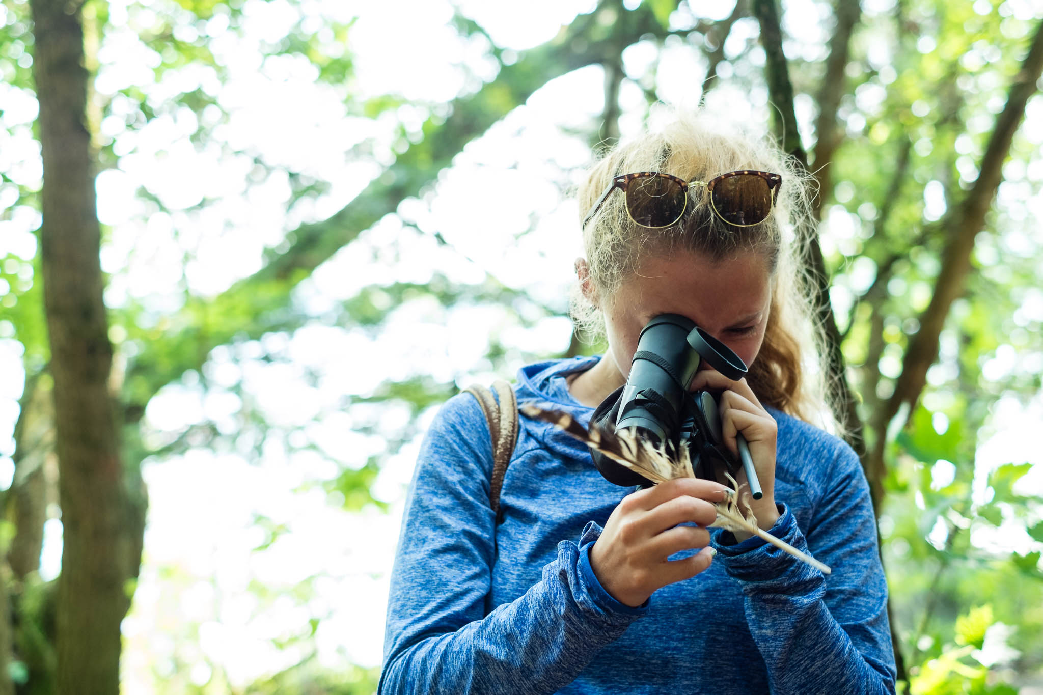 Natural History of Vermont student checks out a barred owl feather.