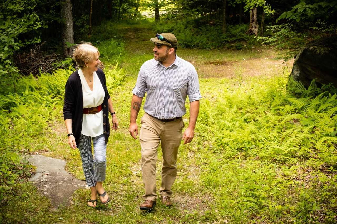 Anne Black and Kyle Aines walk together at The Warrior Connection.