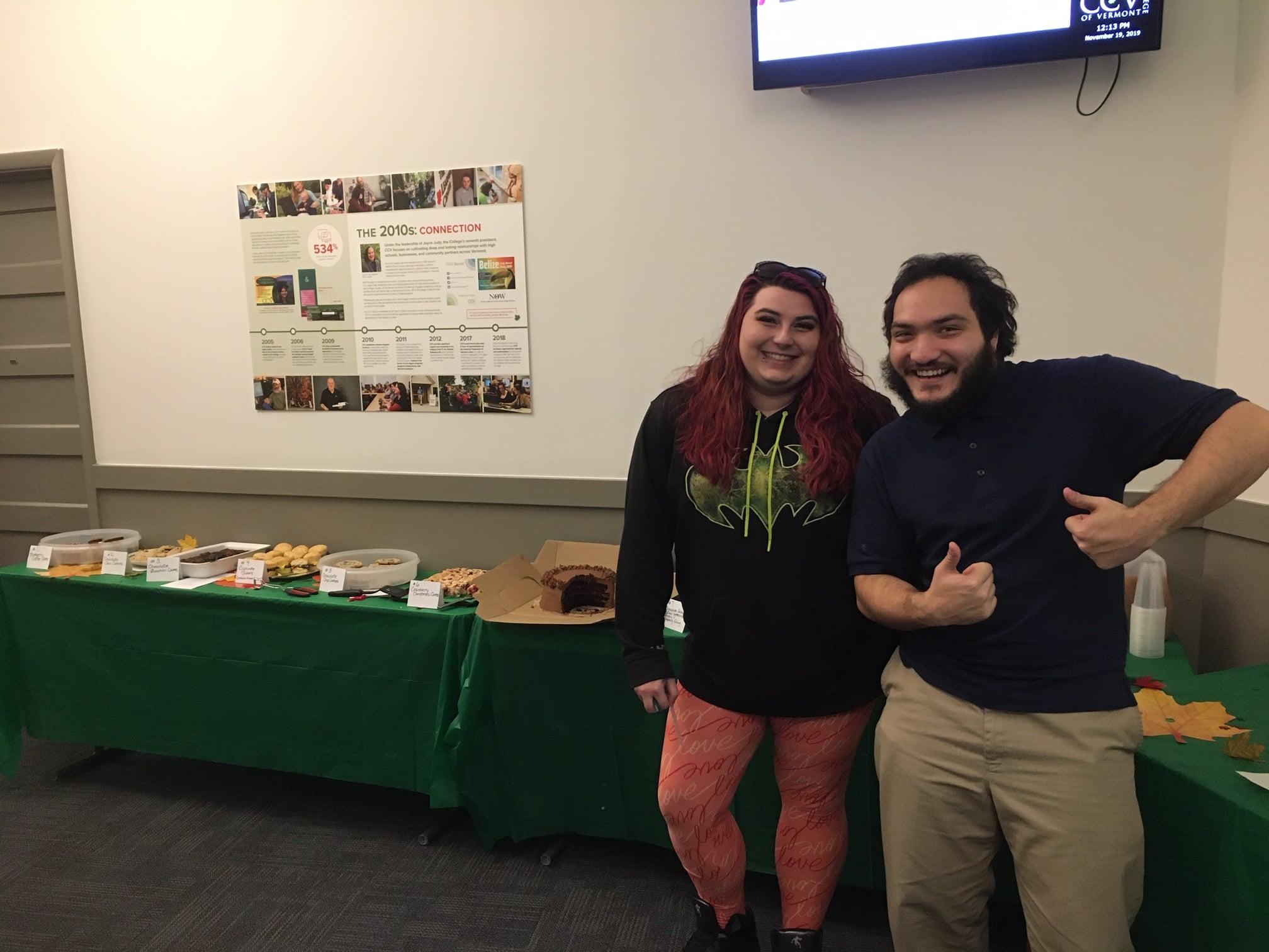 Student Leadership Advisory Council members Josie Winters and Elias Maldonado showcase Middlebury's inaugural Bake-Off on November 19.