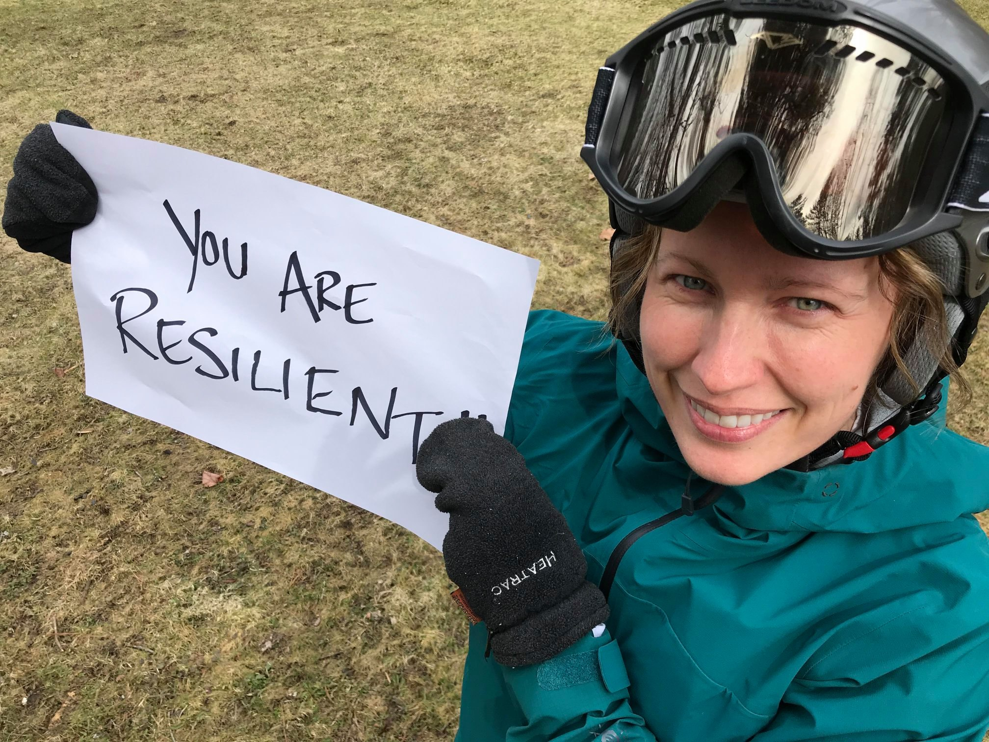 Kate Hughes, CTL, holds up a sign of encouragement for CCV students.